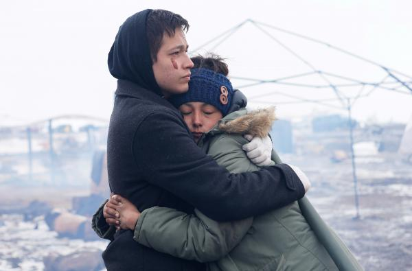 Alex Redbear and Kateri Eagle Staff embrace during a prayer ceremony at the Oceti Sakowin camp earlier today.