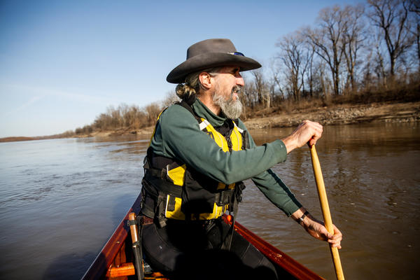 John Ruskey, owner of Quapaw Canoeing Company in Clarksdale, Miss., paddling down the mighty Mississippi River.