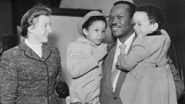After his marriage, the real Seretse Khama spent years in exile. He's shown here in 1956 with his wife, Ruth, and two of their children.