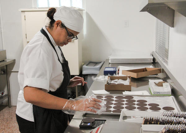 A worker finishes dark chocolate wafers at the Loiza shop.