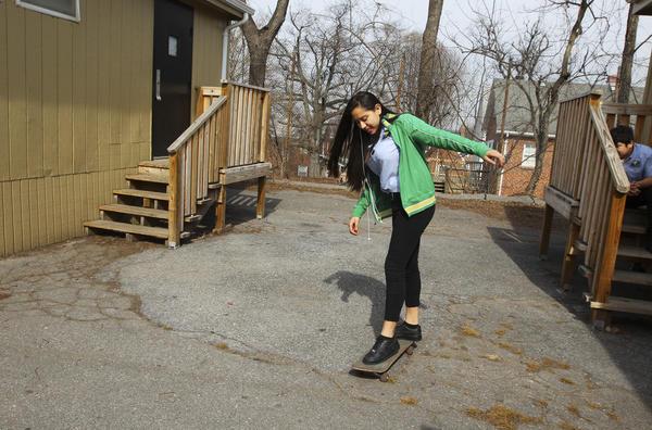 Junior Nury Sola, 16, shows off her skateboard skills during lunch period.