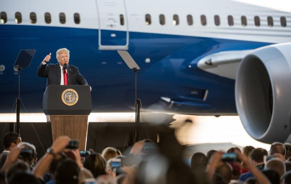 """President Trump addresses a crowd during the debut of the new Dreamliner 787 at Boeing's South Carolina facilities on Feb. 17 in North Charleston. Trump uses Boeing as an example of his """"America First"""" policies, but the plane parts come from all over."""