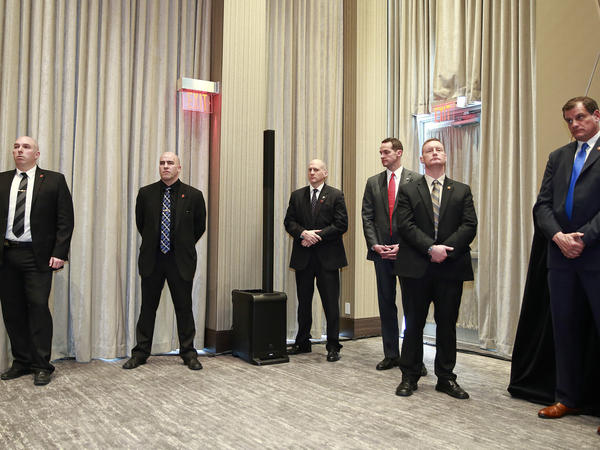 Security personnel look on during the Feb. 28 ceremony opening the Vancouver Trump International Tower and Hotel.
