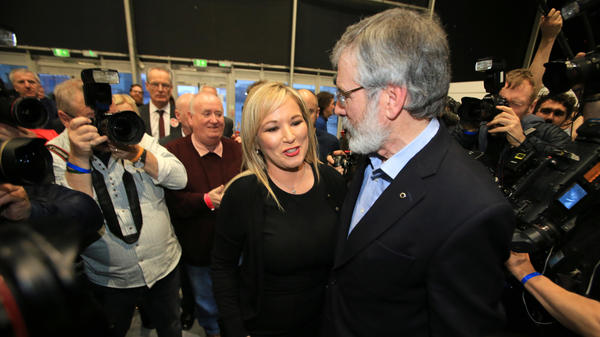 Michelle O'Neill, Sinn Fein's new leader in Northern Ireland, talks with overall party leader Gerry Adams and members of the media in Belfast, Northern Ireland, on Friday. Sinn Fein, which used to be on the U.S. terrorism watchlist for its connection to the so-called Irish Republican Army, saw massive gains in the recent election.