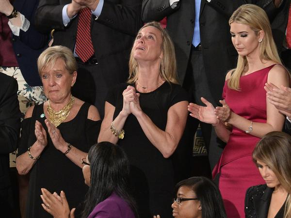 "Carryn Owens, wife of Navy SEAL William ""Ryan"" Owens, is recognized as U.S. President Donald Trump addresses a joint session of Congress last Tuesday."