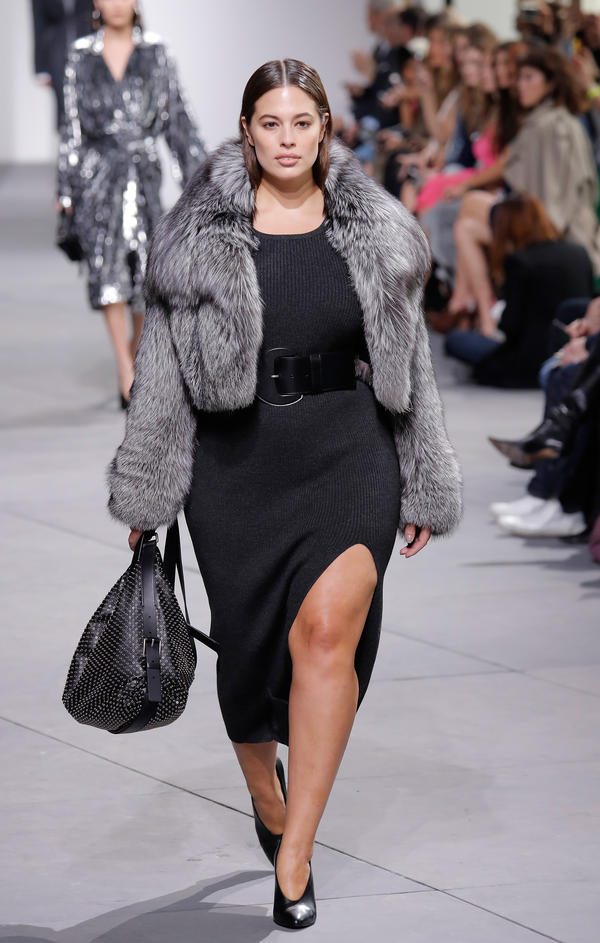 Plus-size model Ashley Graham walks the runway during the Michael Kors Collection Fall 2017 fashion show last month in New York City. UCLA psychologist Janet Tomiyama says there are signs that the strong anti-fat bias in our culture may be shifting.