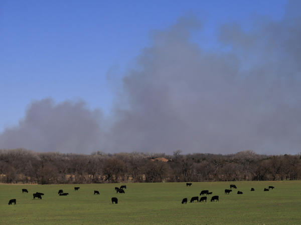 Fires near Hutchinson, Kan., have sent smoke billowing across miles of farmland.