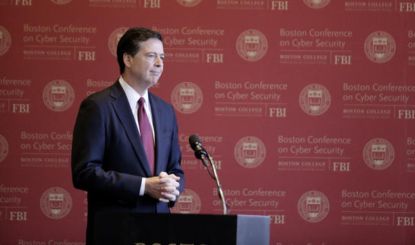 FBI Director James Comey attends the Boston Conference of Cyber Security at Boston College on Wednesday, where he said he has no plans to leave his post before the end of his term.