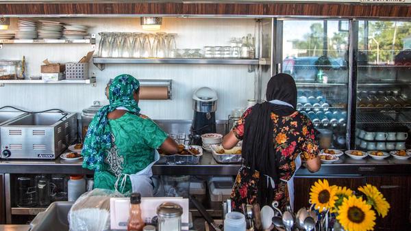 Minara Begum (left) and her sister, Rajna Begum, served coconut <em>Mishti </em>(sweets) at the first Bandhu Gardens pop-up at Rose's Fine Food last July.