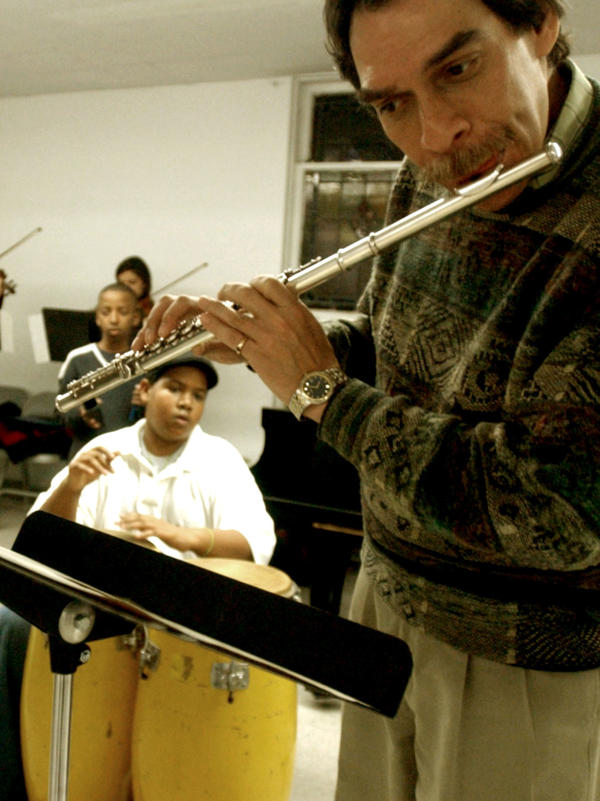 Flutist Dave Valentin rehearses with the children of Opus 118 Harlem Center for Strings in New York in 2003. Valentin died on Wednesday of complications from a stroke and Parkinson's disease.