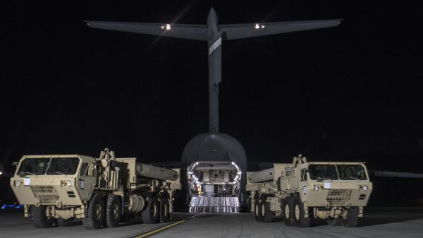 In this photo provided by U.S. Forces Korea, trucks carrying U.S. missile launchers and other equipment needed to set up the Terminal High Altitude Area Defense (THAAD) missile defense system arrive at the Osan air base in Pyeongtaek, South Korea on Monday.