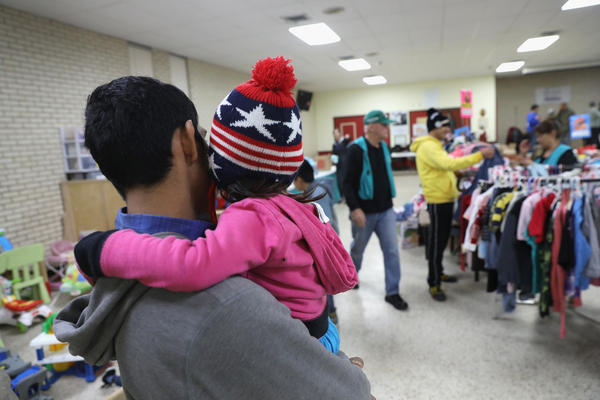 Immigrants choose donated clothing at the Catholic Charities Respite Center on Jan. 6, 2017 at the Sacred Heart Catholic Church in McAllen, Texas. The center helps thousands of immigrants.
