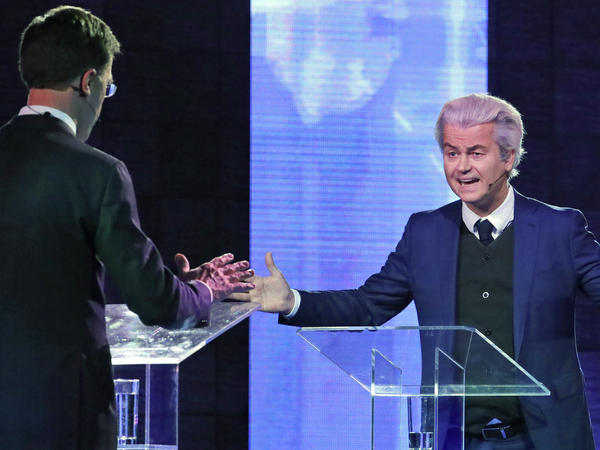 Right-wing Dutch populist leader Geert Wilders gestures as he talks to Prime Minister Mark Rutte during a national televised debate on Monday. Wilders' Freedom Party had been leading in the polls until recently.