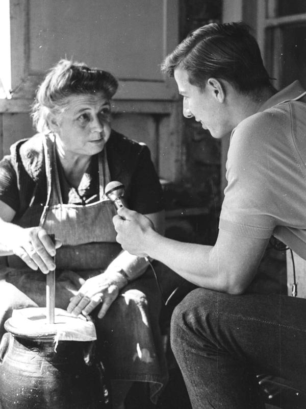 Margaret Norton, who is prominently featured in the first <em>Foxfire</em> book, churns butter as she is being interviewed by a student in 1967.