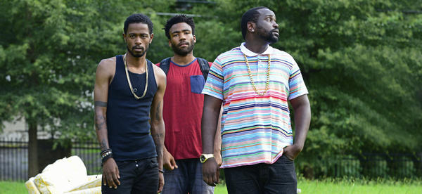 Lakeith Stanfield (left), Donald Glover (center) and Brian Tyree Henry in a still from Glover's series <em>Atlanta</em>, which depicts the life of a trap rapper and his cousin, an Ivy League dropout.
