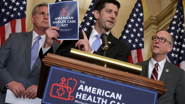House Speaker Paul Ryan holds a copy of the American Health Care Act, the House Republican leadership's plan to repeal and replace the Affordable Care Act, which is already facing opposition from conservatives in the House and Senate.