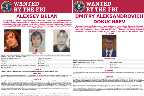 "Both Alexsey Belan (left) and Dmitry Dokuchaev (right) were included in the series of ""wanted"" posters for Russians accused of cybercrimes Wednesday."