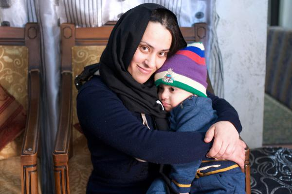 Abeer Mahameed, 29, who lives in Umm al-Fahm, embraces her two-year-old son, Mustafa. She heeded her municipality's boycott of Hamoud's film, saying it portrays Palestinian women as impure.
