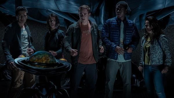 Zack (Ludi Lin), Kimberly (Naomi Scott), Jason (Dacre Montgomery), Billy (RJ Cyler) and Trini (Becky G) check the time, to determine if conditions are yet favorable for morphin', in <em>Power Rangers</em>.