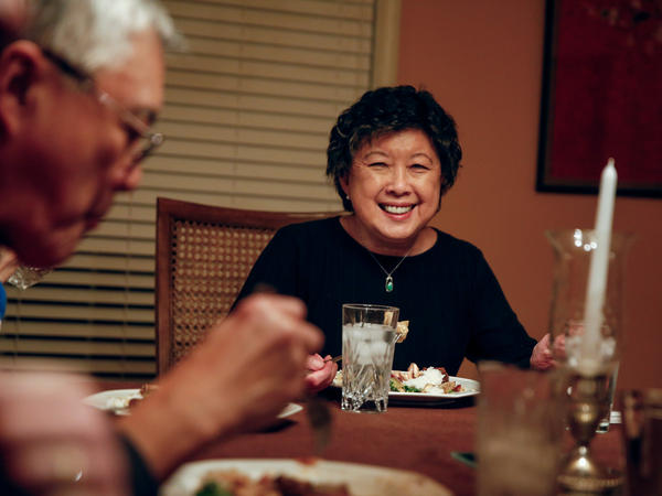 Sally Chow shares a meal with friends and family in her home in Clarksdale, Miss.,
