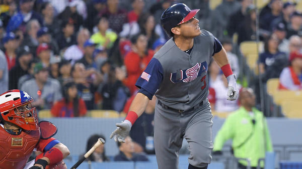 United States' Ian Kinsler watches his two-run home run against Puerto Rico on Wednesday during the third inning of the final of the World Baseball Classic in Los Angeles.