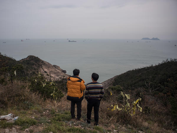 Relatives of victims of the Sewol ferry disaster observe efforts to raise the sunken vessel from a vantage point on the southern island of Donggeochado, South Korea.