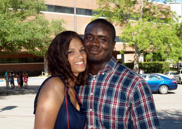 Jonathan Ferrell (right) with his fiancé, Caché Heidel.