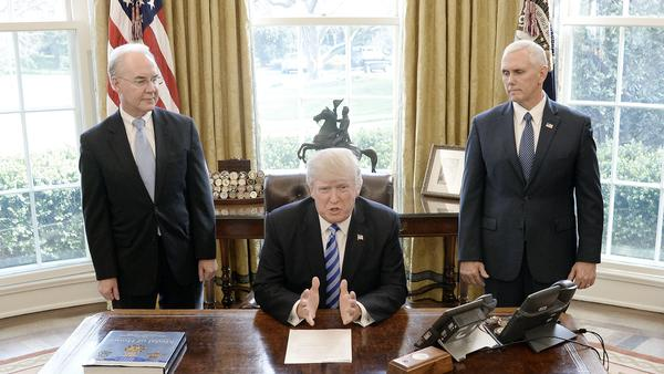 Flanked by HHS Secretary Tom Price and Vice President Pence, Donald Trump reacts after Republicans abruptly pulled their health care bill from the House floor.