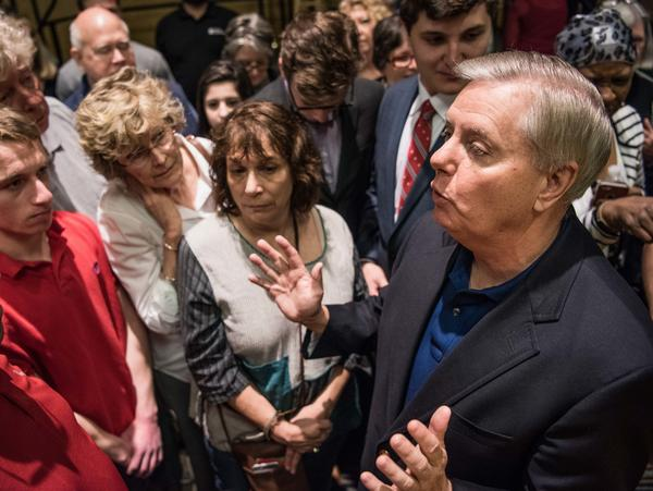 Sen. Lindsey Graham talks with constituents after a town hall meeting today in Columbia, S.C. Protestors have been showing up in large numbers to congressional town hall meetings across the nation.