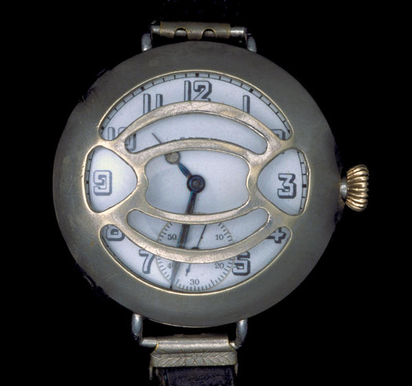 "A 1917 Elgin wristwatch, which many American officers wore in World War I. Prior to the war, men rarely wore wristwatches, but officers needed them to coordinate movements across a vast battlefield. The watch has a ""shrapnel guard"" to protect the face of the watch."