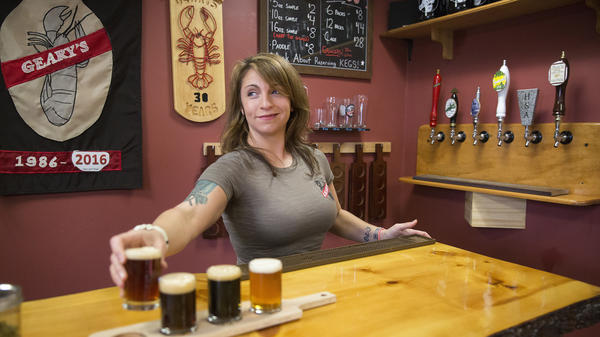 Craft breweries now account for 5,234 of 5,301 U.S. beer makers, according to an industry group's annual tally. Here, Danielle Coons, the tasting room ambassador at D.L. Geary Brewing Co.<strong> </strong>serves a beer in Portland, Maine, last November.