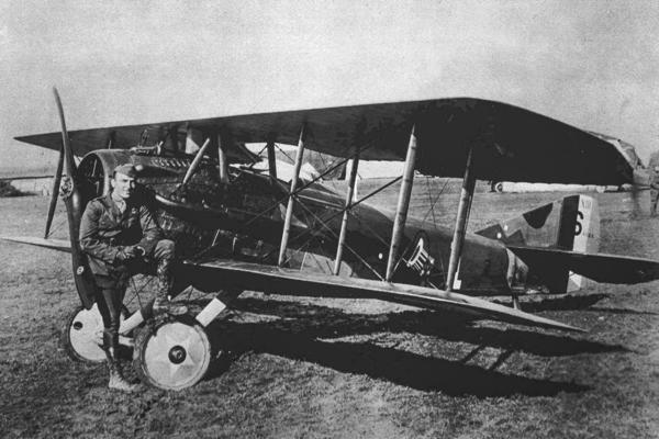 American World War I fighter pilot Eddie Rickenbacker poses with his plane in this undated photo. During the war, airplanes were employed at first for reconnaissance, but air battles soon followed as each side tried to shoot down the enemy's observation planes. The early planes were short on reliable cockpit gauges. Pilots used wristwatches to help determine how much fuel they had left.