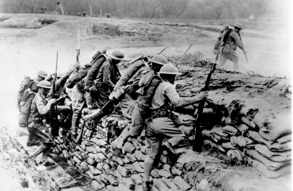 American troops climb over a sandbag barrier in France during World War I in 1918. The U.S. waited almost three years before entering the war, but the fresh American troops played a major role in deciding the outcome of a conflict that has been locked in stalemate. April 6 marks the 100th anniversary of the U.S. entrance into the war.