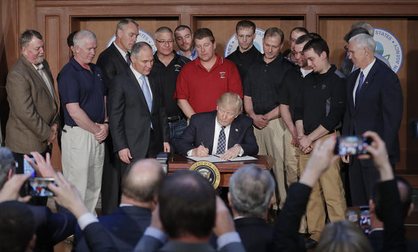 President Donald Trump signs an Energy Independence Executive Order on Tuesday at EPA headquarters in Washington.
