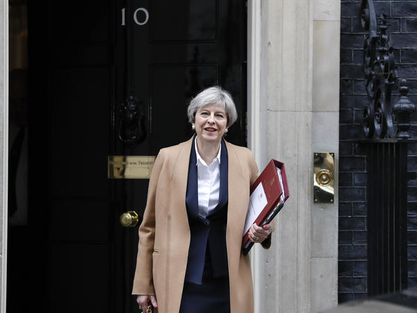 Britain's Prime Minister Theresa May leaves 10 Downing St. on her way to the House of Commons in London on Wednesday to speak to Parliament.