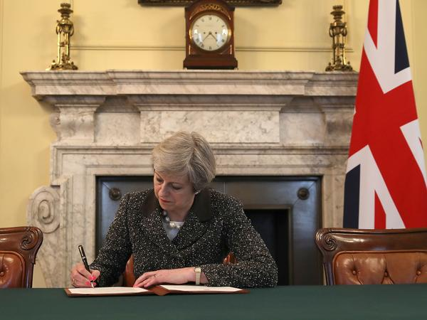 Britain's Prime Minister Theresa May signs the official letter to European Council President Donald Tusk invoking Article 50 and signaling the United Kingdom's intention to leave the EU.