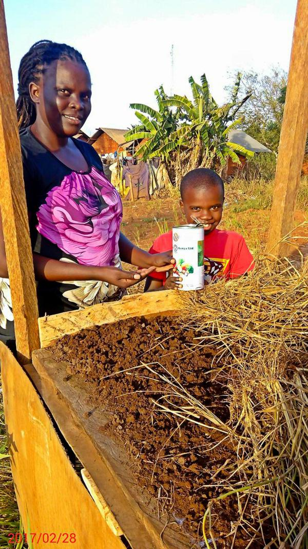 Faith and her son, William, are ready to plant some coriander seeds.