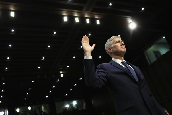 Judge Neil Gorsuch is sworn in on the first day of his Supreme Court confirmation hearing before the Senate Judiciary Committee on Capitol Hill on March 20, 2017.