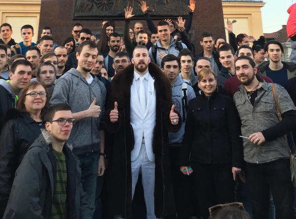 """Presidential candidate Ljubisa """"Beli"""" Preletacevic, the satirical alter-ego of Serbian college student Luka Maksimovic, poses with supporters in the main square of the Serbian town of Zrenjanin."""