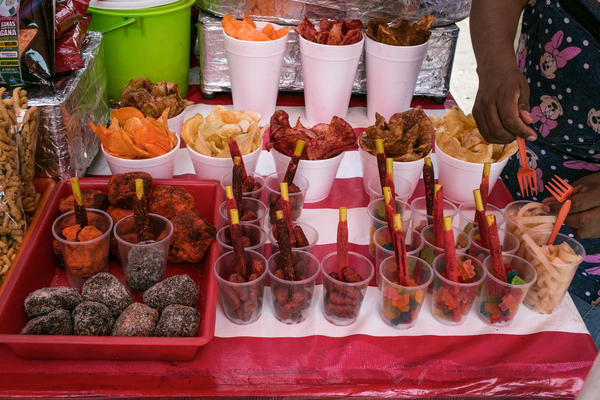 Gummy bears, potato chips and other snacks are sold on the sidewalk in downtown Mexico City. A study in 2015 ranked Mexico as the No. 1 consumer of junk food in Latin America: 450 pounds per person each year.