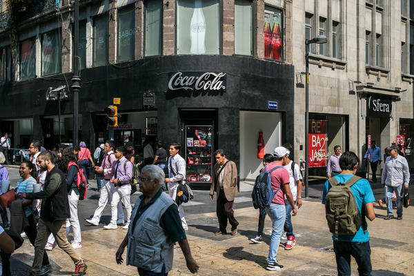 Crowds pass a Coca-Cola store in Mexico City's Centro Historico district. In 2015, the average Mexican drank nearly two glasses of Coke a day.