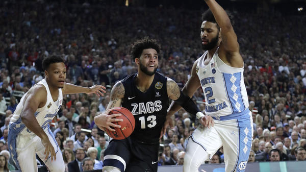 Gonzaga guard Josh Perkins drives past North Carolina guard Joel Berry II, right, Monday during the first half in the NCAA college basketball tournament finals in Glendale, Ariz.