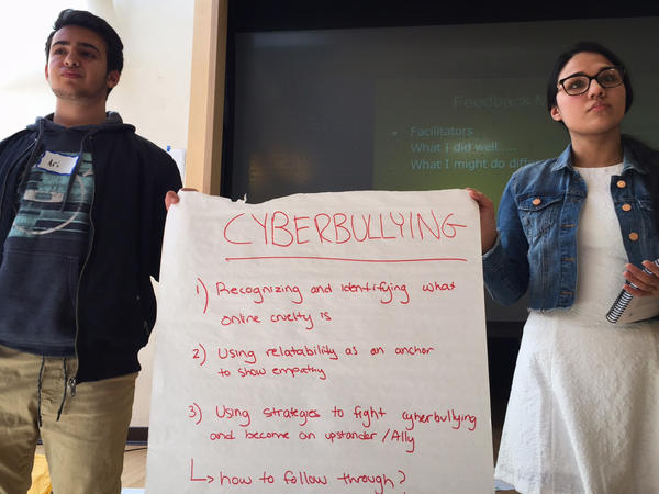 Brookline High School students Ari Lazowski (left) and Iman Khan practice presenting an exercise on cyberbullying.
