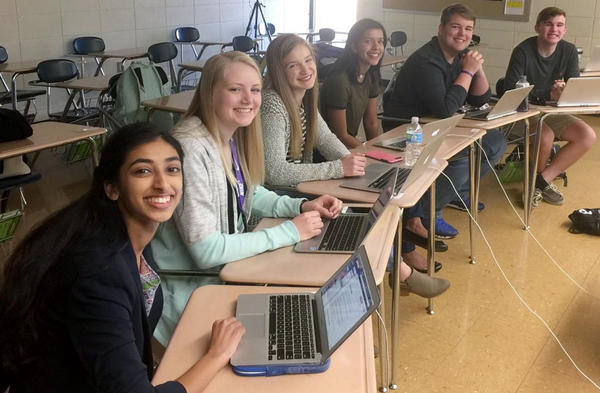 Students Gina Mathew (from left), Kali Poenitske, Maddie Baden, Trina Paul, Connor Balthazor and Patrick Sullivan at Pittsburg High School in Pittsburg, Kan. When reporters for the student newspaper there dug into the credentials offered by their new principal, they found issues that led to her resignation.