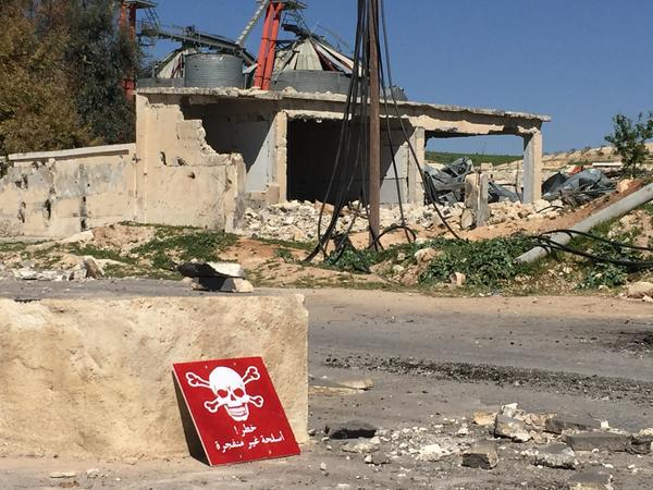 A poison hazard danger sign is seen in the town of Khan Shaykun, Idlib province, Syria. At least 70 civilians, including 20 children, were killed in a suspected chemical attack in the town.