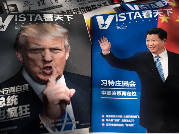 Magazines at a Beijing newsstand show images of President Trump and Chinese President Xi Jinping. The two leaders are meeting at Mar-a-Lago Thursday and Friday.
