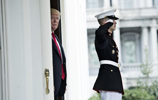 President Trump waits to greet Denmark's Prime Minister Lars Lokke Rasmussen outside the West Wing of the White House on March 30. Trump's approach to foreign policy has changed since he took office.
