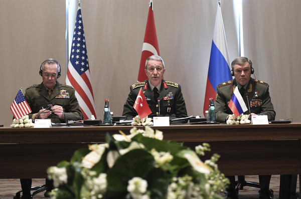 U.S. Chairman of the Joint Chiefs of Staff Gen. Joseph Dunford (left) and Russia's Chief of Staff Gen. Valery Gerasimov (right) attend a meeting with Turkey's Chief of Staff Gen. Hulusi Akar in Antalya, Turkey, on March 7. Dunford and Gerasimov have met twice since President Trump's inauguration; before that, the last meeting on that level took place before Russia's annexation of Crimea in 2014.