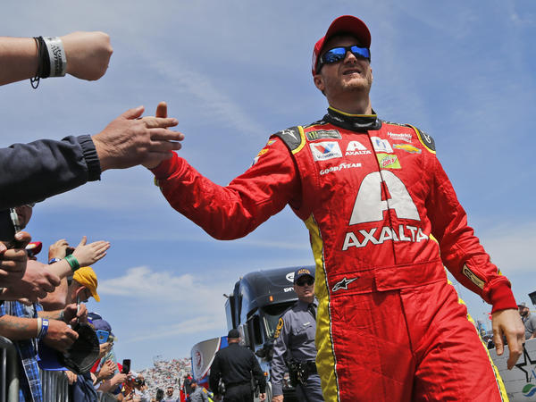 Dale Earnhardt Jr., greets fans during driver introductions for the NASCAR Cup Series auto race at Martinsville Speedway in Martinsville, Va., last Sunday.