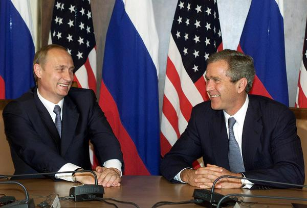 "Russian President Vladimir Putin meets President George W. Bush at the G-8 economic summit in Genoa, Italy on July 22, 2001. The leaders initially had a good relationship. But shortly before Bush left office, he told Putin, ""Vladimir, you're cold-blooded."""